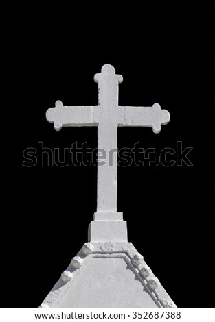 White cross in cemetery on black background.