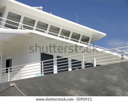 white Cruise ship bridge against blue sky - stock photo