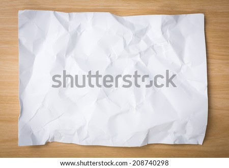 White  crumpled paper on a wooden desk - stock photo