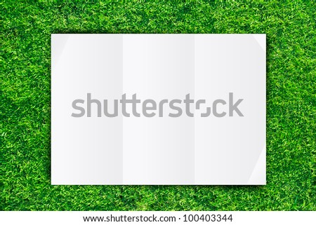 White Crumpled paper on Grass background - stock photo