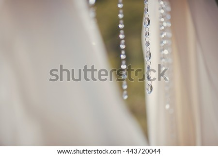 White crystals hang between light curtains
