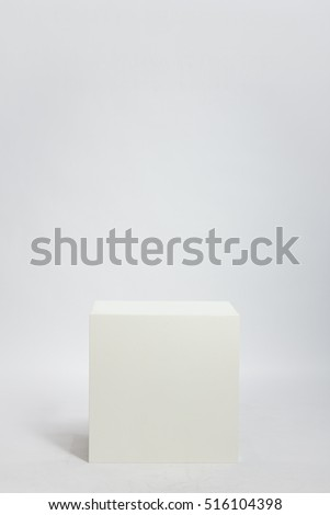 white cube on a white background (in the studio on the cyclorama)