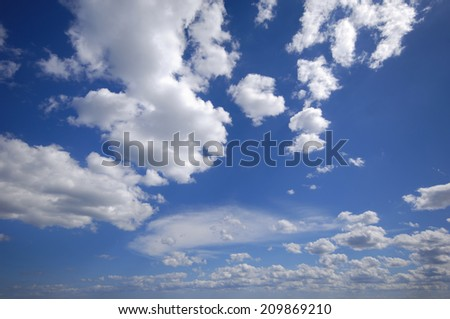 White cumulus clouds and blue sky - stock photo