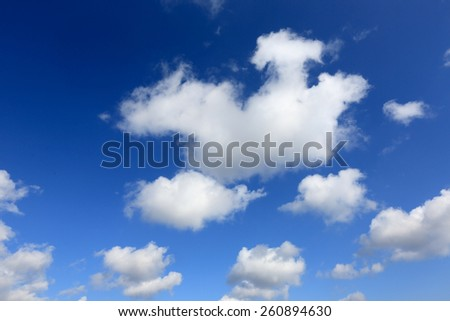 white cumulus clouds in blue sky  - stock photo