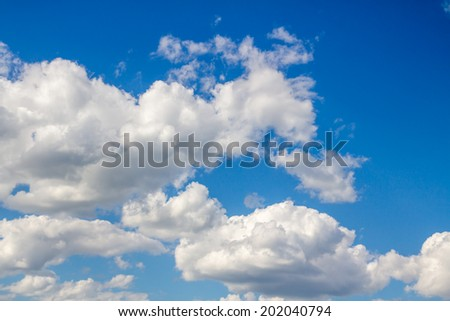 white cumulus clouds in the blue sky