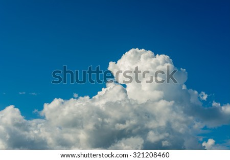 white cumulus clouds in the blue sky for background usage.