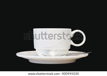 white cup and saucer isolated on black background with clipping path