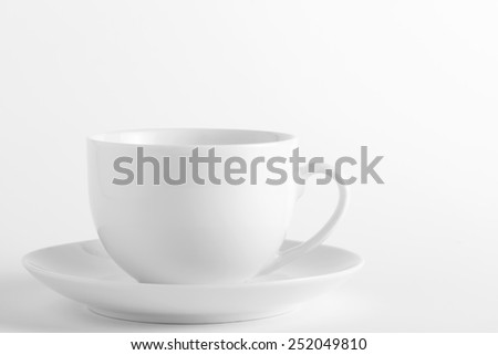 White cup and saucer on a white background - stock photo