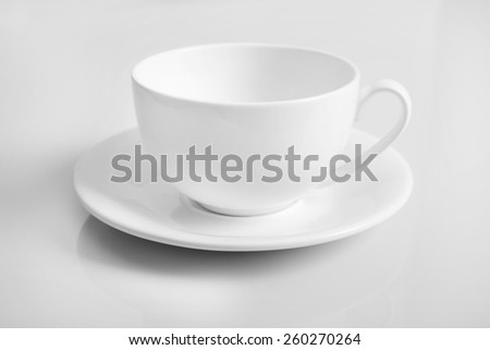 White cup isolated on white - stock photo