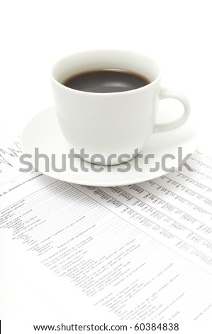 White cup of cappuccino on paper table numbers.