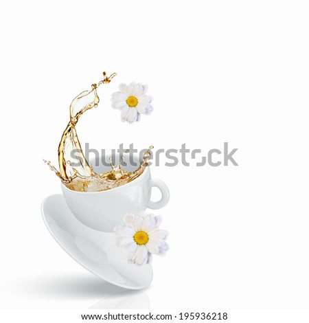 White cup of chamomile tea against white background - stock photo