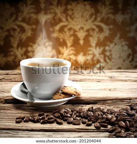 white cup of coffee and grains