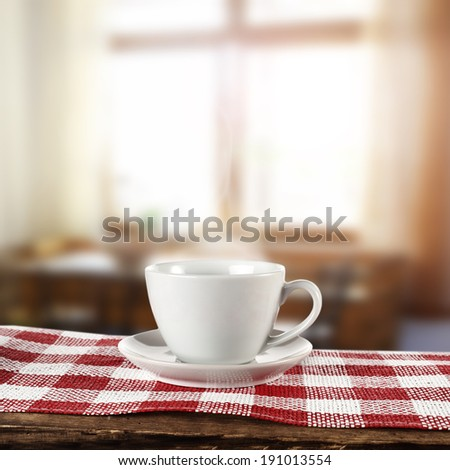 white cup of coffee and morning window in home  - stock photo