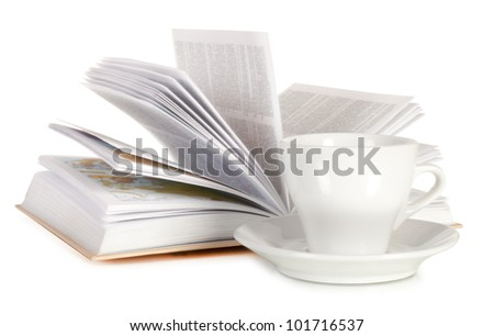 White cup of coffee and open book isolated on white background