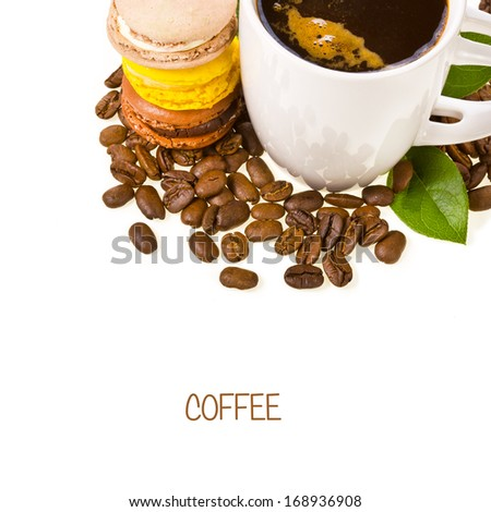 white cup of coffee, coffee beans spilling around and dessert macaroons isolated on white background - stock photo