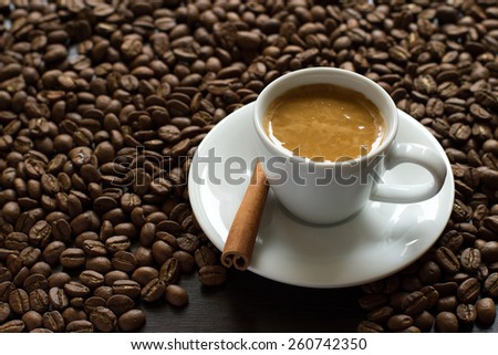 White cup of coffee on a background coffee beans - stock photo