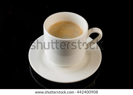 white cup of coffee on a black background - stock photo