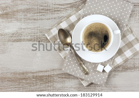 White cup of coffee on vintage wood. Top view. - stock photo
