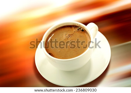 white cup of  coffee with saucer on colorful background close-up  - stock photo