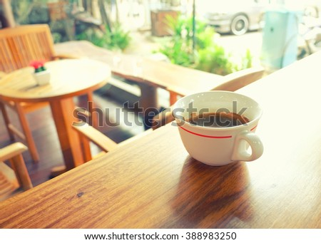 White cup of hot coffee in Coffee shop,refreshing concept -Vintage effect style. - stock photo