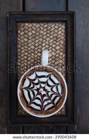 white cup of hot coffee on  weaving tray