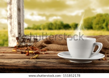 white cup of hot drink  - stock photo