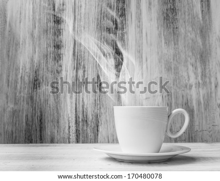 White cup of hot drink on a wooden background - stock photo
