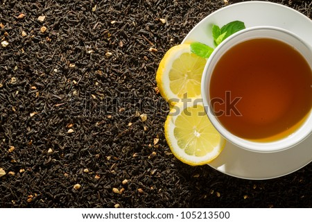 White cup of tea on dark background - stock photo