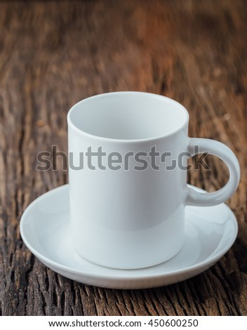 white cup on wooden background - stock photo