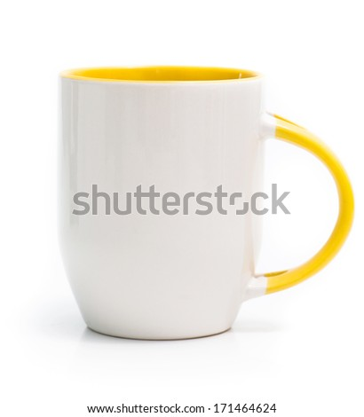 white cup with a yellow handle and an inner surface isolated on white background - stock photo