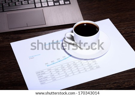 White cup with black coffee at business workplace - stock photo