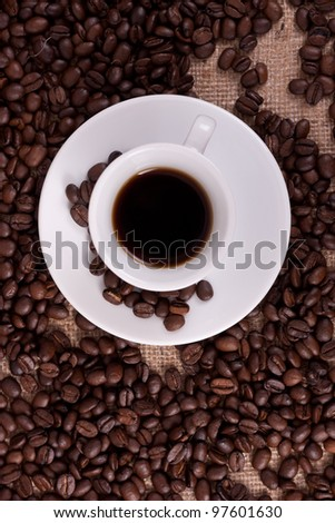 White cup with coffee - stock photo