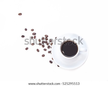 White cup with coffee and coffee beans on a white background