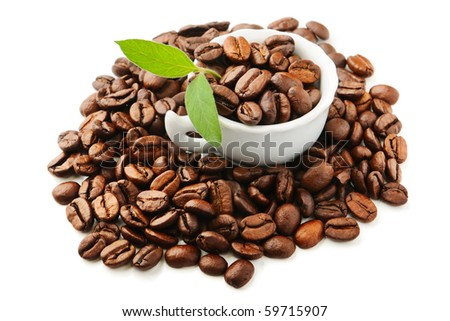 white cup with  coffee beans and leaves - stock photo