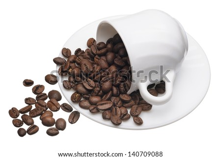 White cup with coffee grains on a white background, isolated