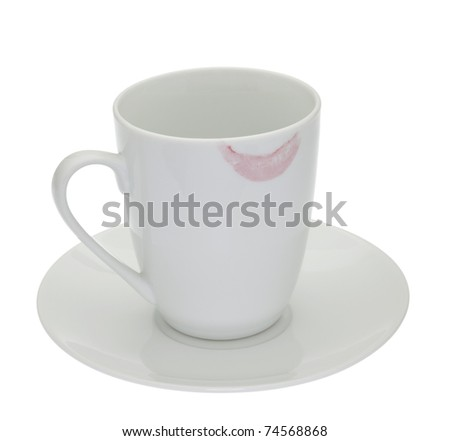 White cup with lipstick mark on rim isolated