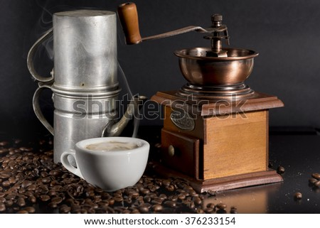 white cup with old Neapolitan coffee on black background - stock photo