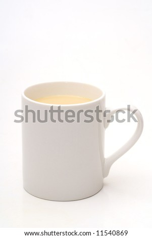 White cup with the tea with the milk - stock photo
