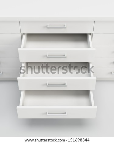 white cupboard with opened empty drawers - stock photo