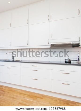 white cupboards, kitchen interior - stock photo