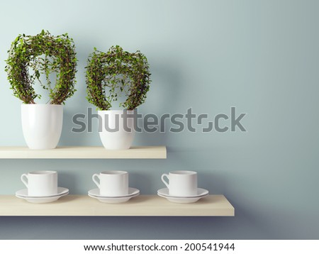 White cups and flowerpot on the shelf in front of gray wall.  - stock photo