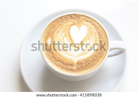 white cups of Cappuccino coffee with froth heart shaped - stock photo
