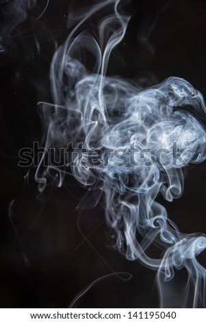 White Curling Smoke On Black Background