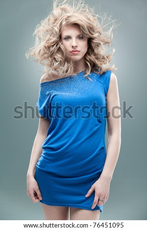 white curly blonde looking blue dress