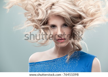 white curly blonde looking blue dress - stock photo