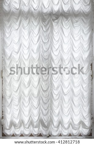 White curtains at the window, close-up how the background