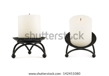 White cylindrical candle on the black forged metal stand, isolated over white background, set of two foreshortenings - stock photo