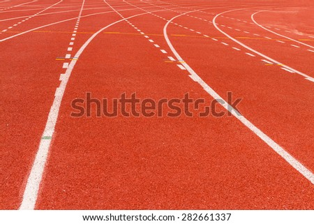 white dash line on red running track