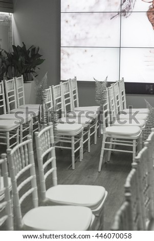 White decorated wedding chairs