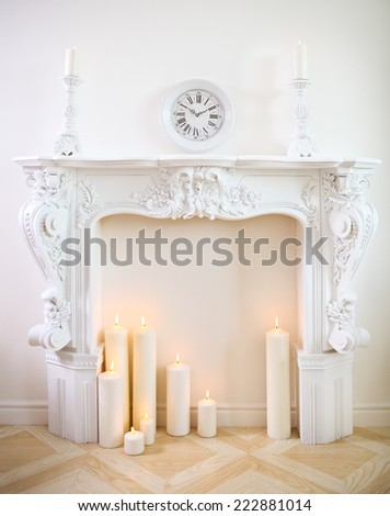White decorative fireplace with candles - stock photo